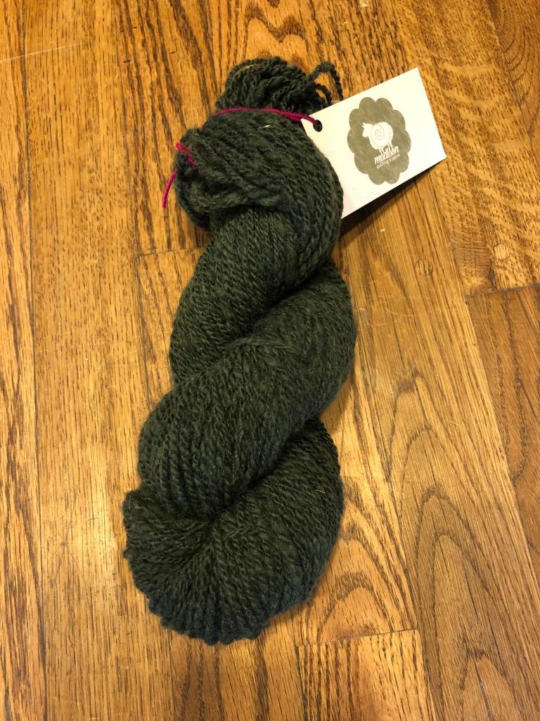 1 skein of Green 2-ply wool yarn.