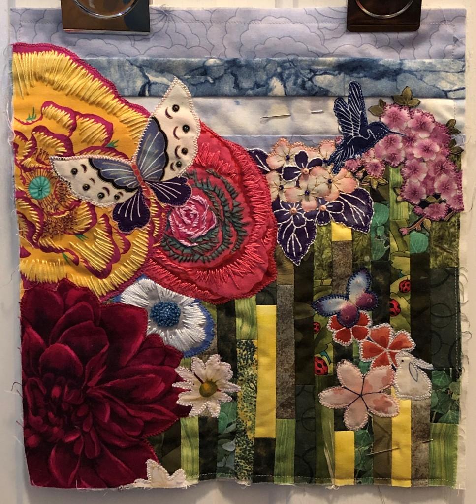 Art quilt celebrating pollinators.