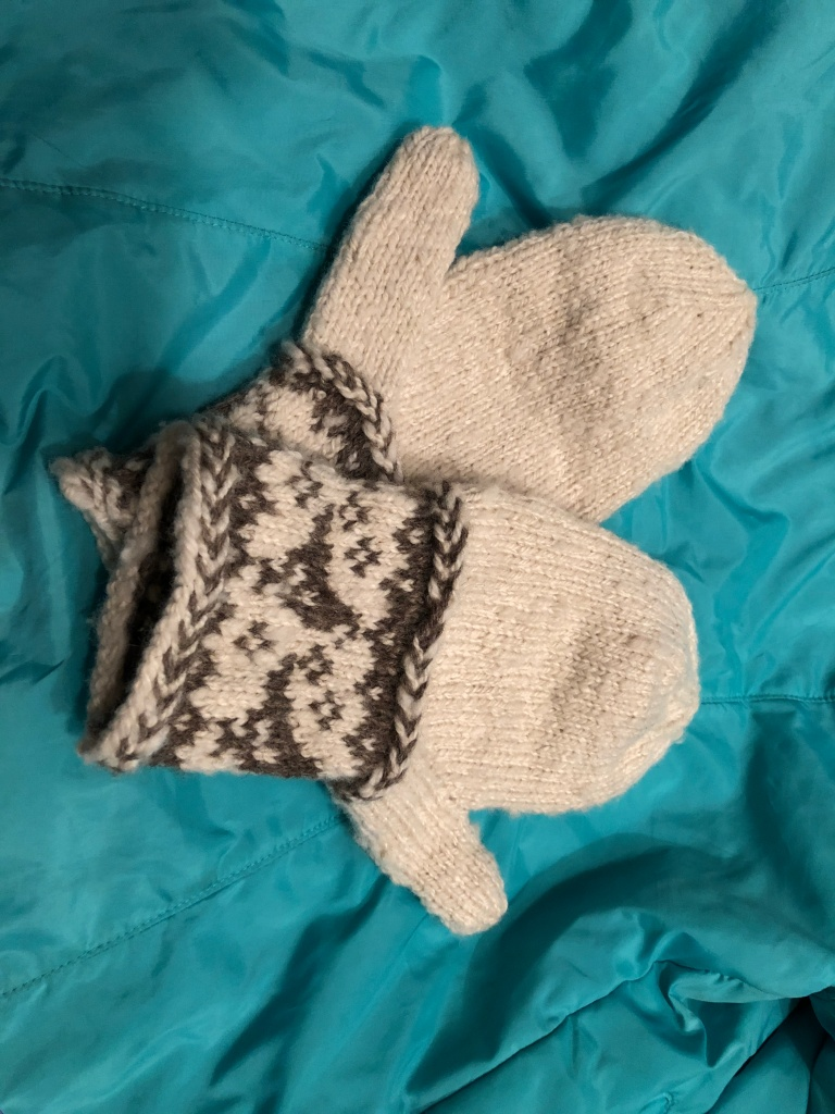 Brown and white hand knitted mittens from handspun Shetland wool.